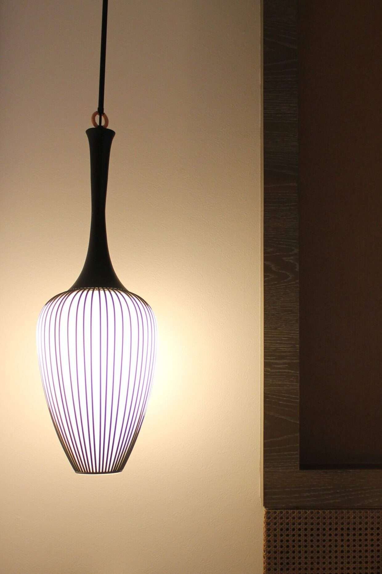lamp in the shape of a paint brush hangs beside the bed at Silks Place Tainan