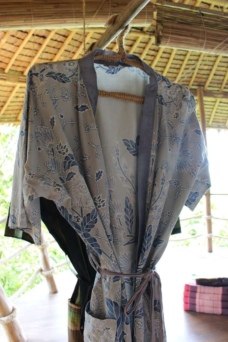 patterned kimonos hang inside the treehouse at The Island Hideout Koh Yao Noi