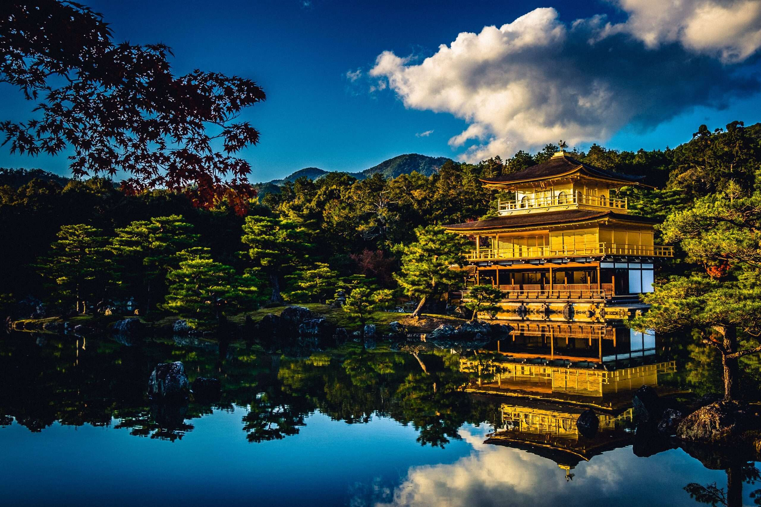 Kinkakuji, the golden pavillion reflecting in the pond in Kyoto, Japan