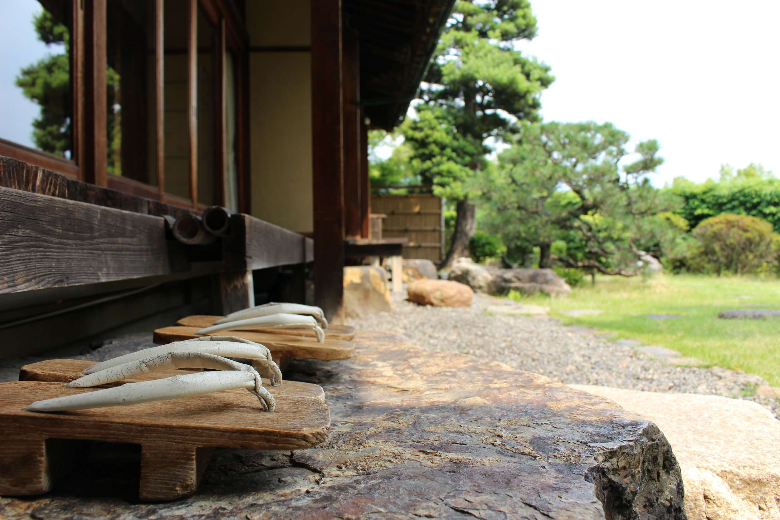 Traditional wooden shoes at Yoshida Sanso Ryokan in Kyoto, Japan