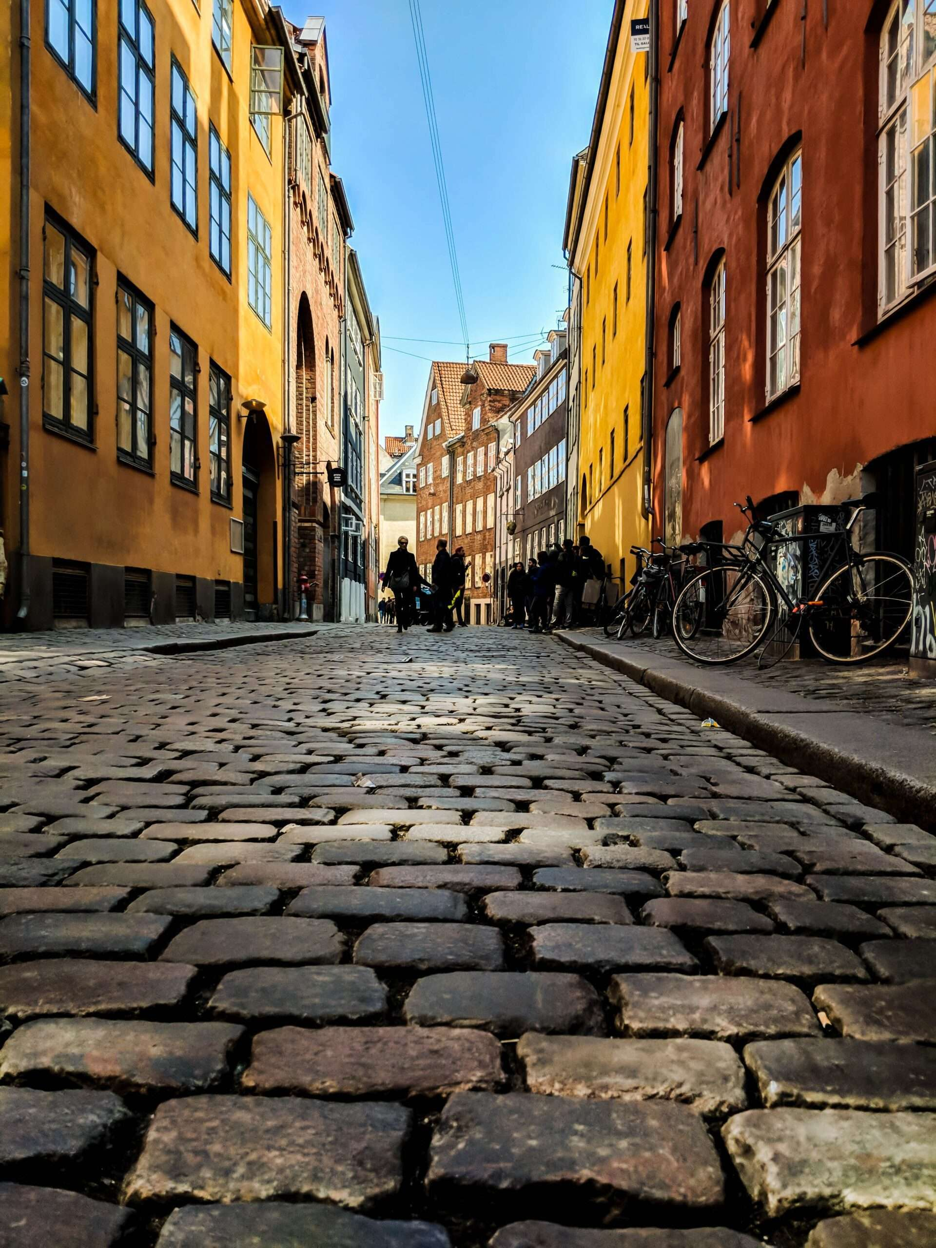 cobbled streets lined with brightly coloured houses in Copenhagen