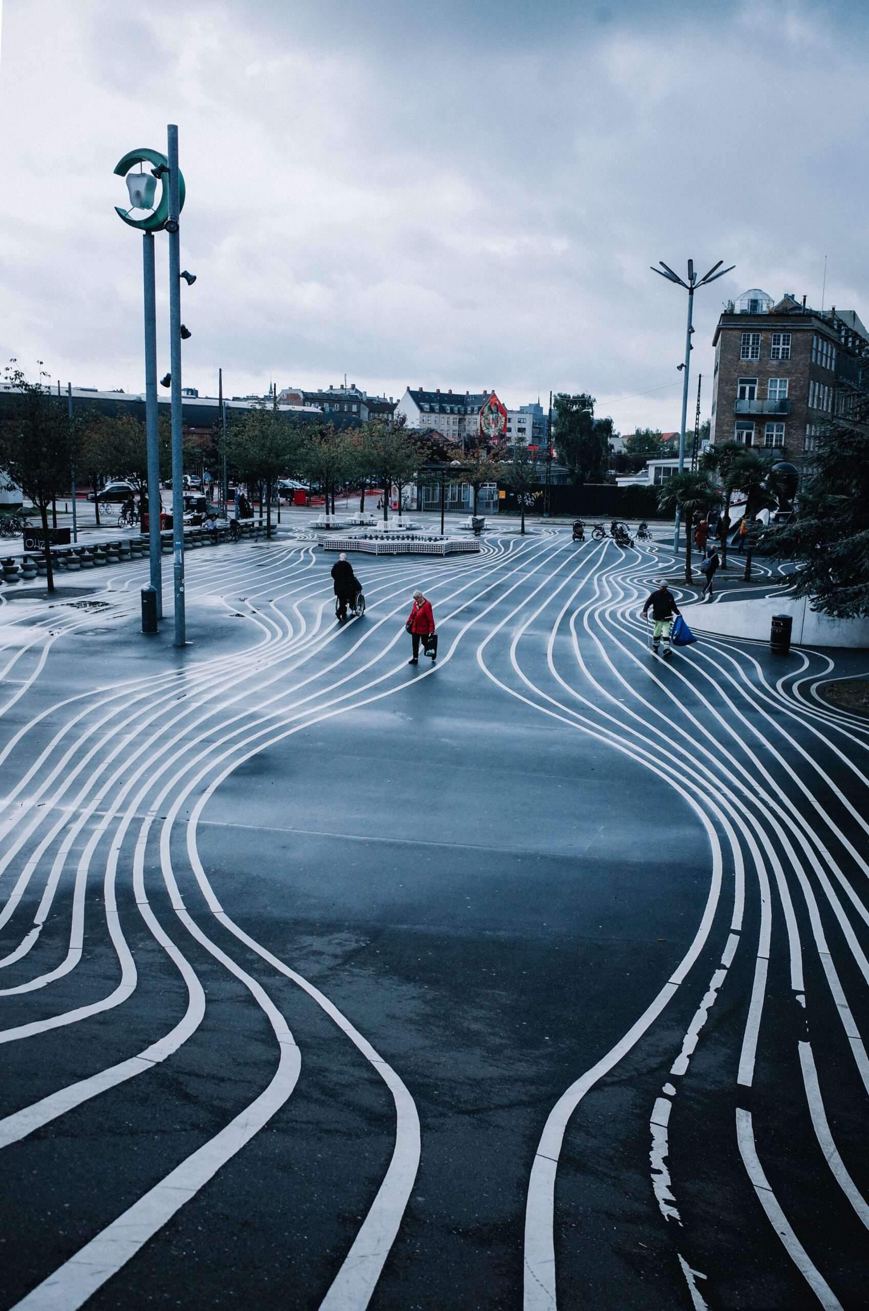 wavy white lines along the dark ground at Superkilen park in Copenhagen
