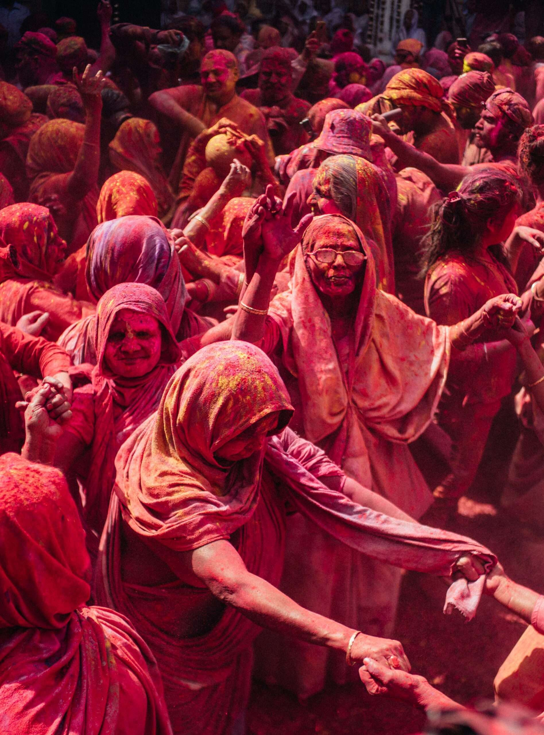 Dozens of people gather to celebrate the colourful festival of Holi in India