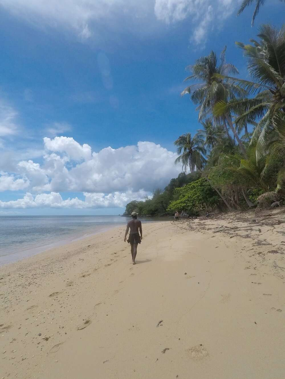 Man walking down the beach in the Philippines