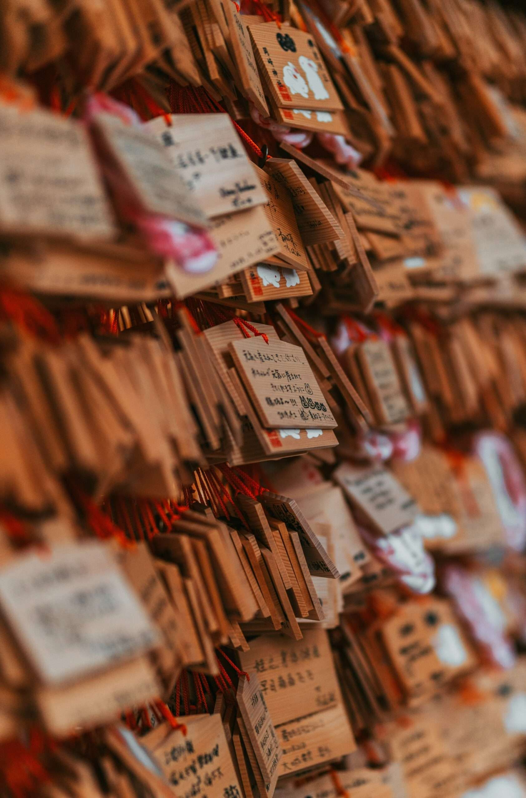 prayer tags hand at a place of worship in Kyoto, Japan