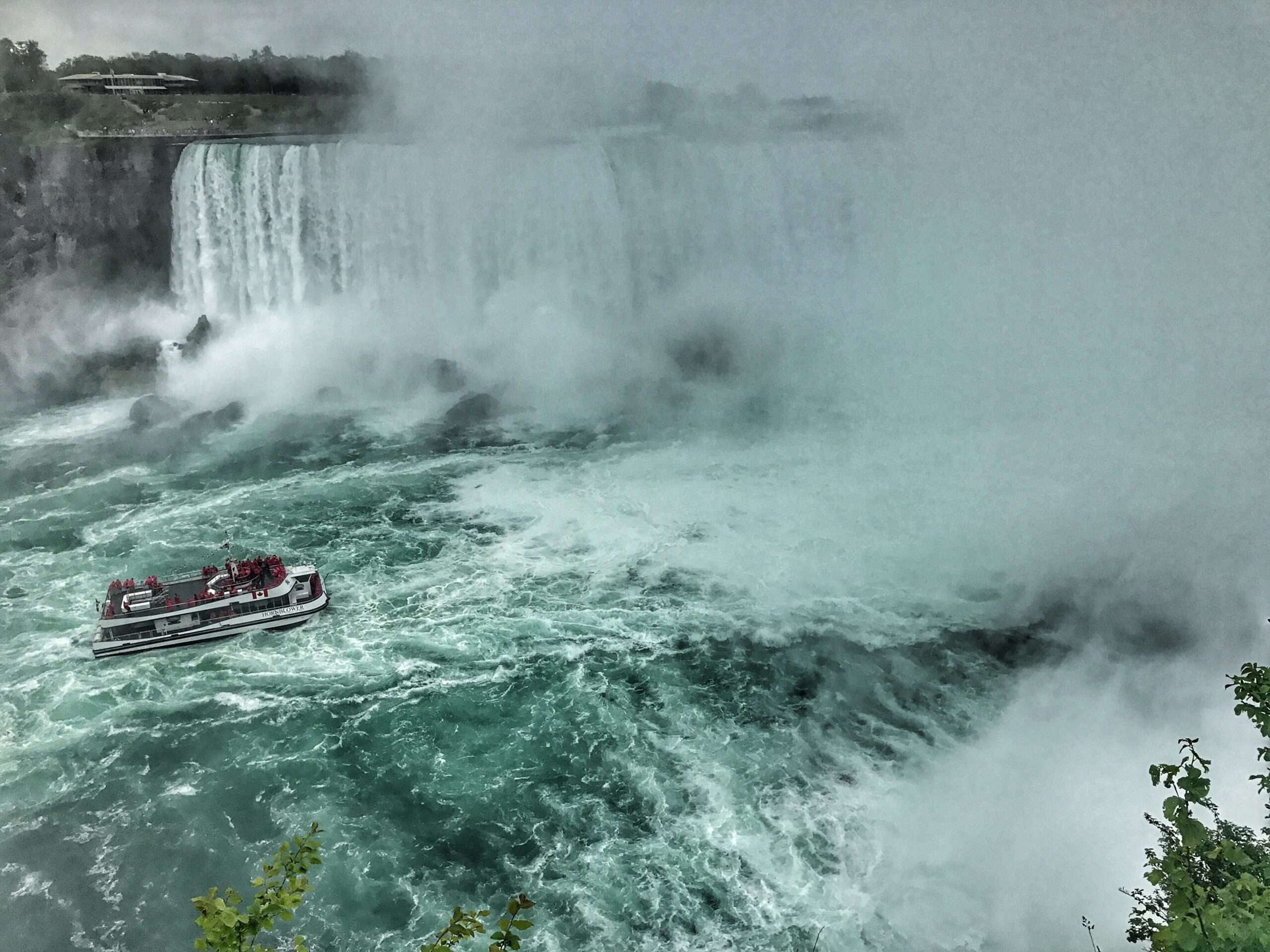 Niagara Falls with a boat on the water