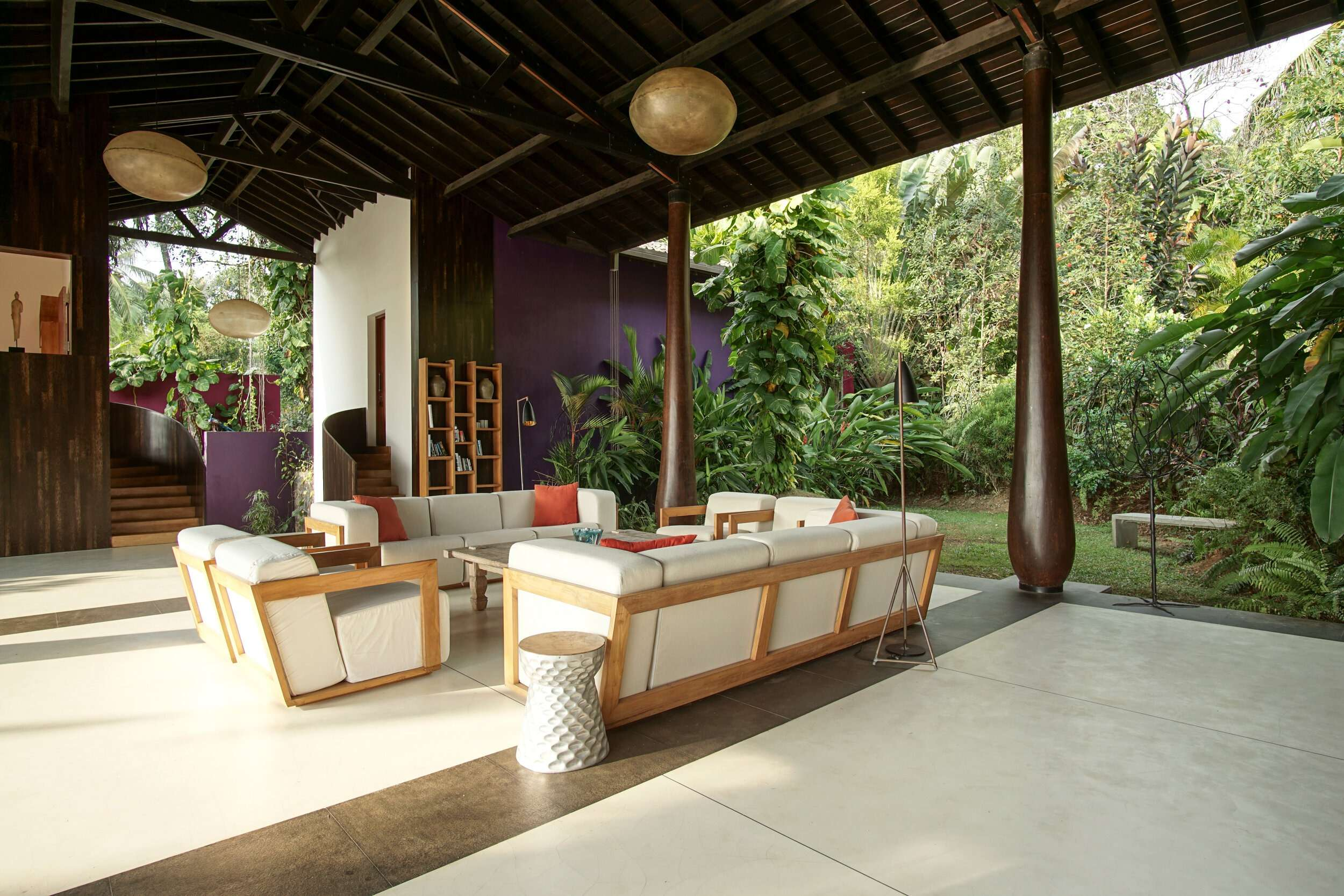 soft light in the main lounge at Villa Wambatu with white sofas and lots of tropical trees