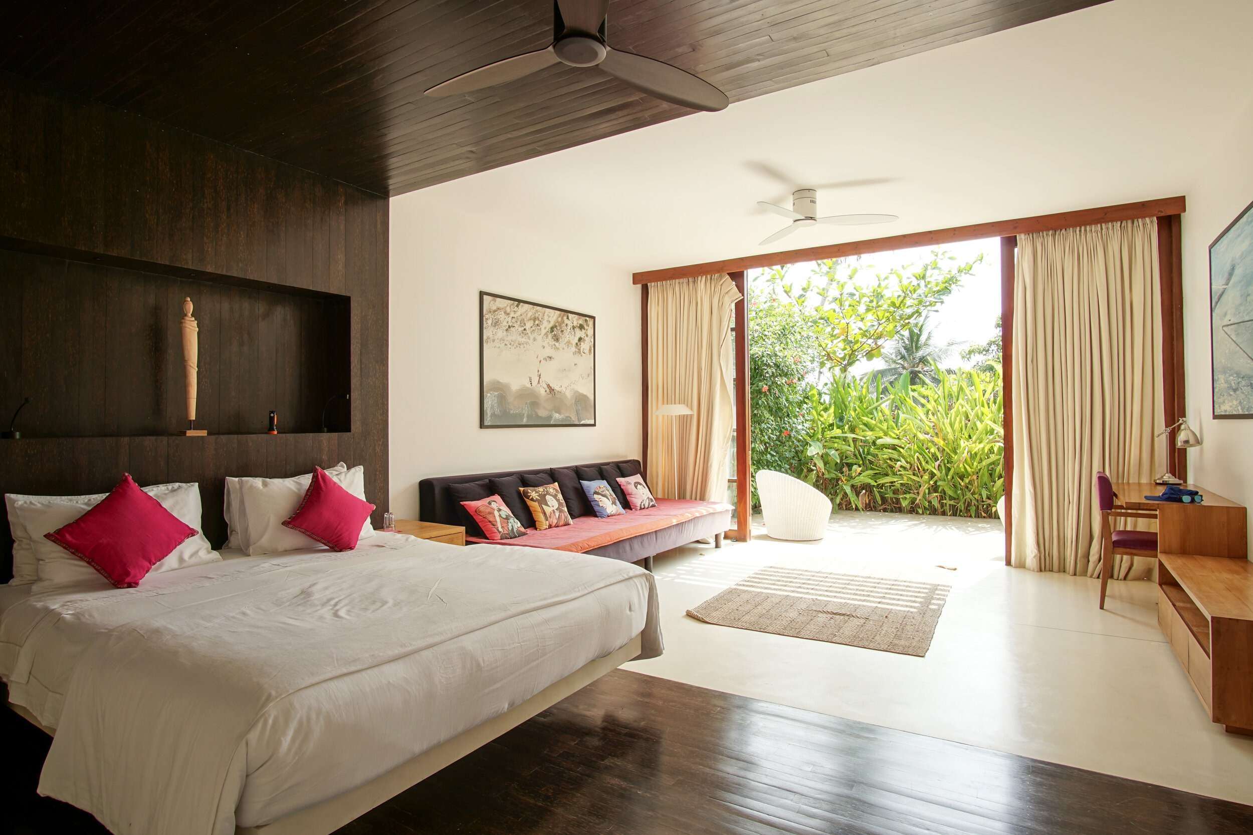 Master bedroom at Villa Wambatu, looking out to the patio with lush greenery
